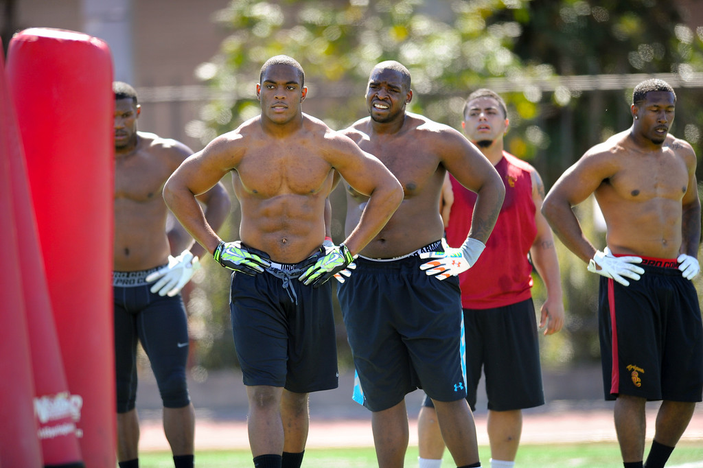 . Devon Kennard, front, and teammates rest between drills at USC Pro Day, Wednesday, March 12, 2014, at USC. (Photo by Michael Owen Baker/L.A. Daily News)