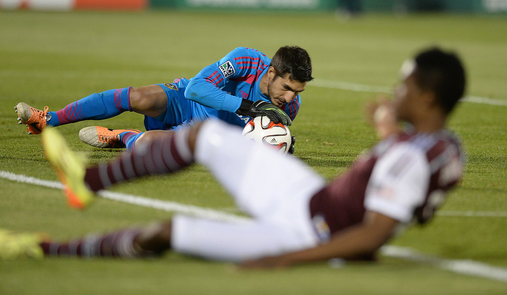 . COMMERCE CITY, CO - MAY 3:  Los Angeles goalie  Jaime Penedo controlled the ball in front of a sliding Colorado forward Deshorn Brown in the second half. The Colorado Rapids defeated the Los Angeles Galaxy 1-0 Saturday night, May 3, 2014 at Dick\'s Sporting Good Park. (Photo by Karl Gehring/The Denver Post)