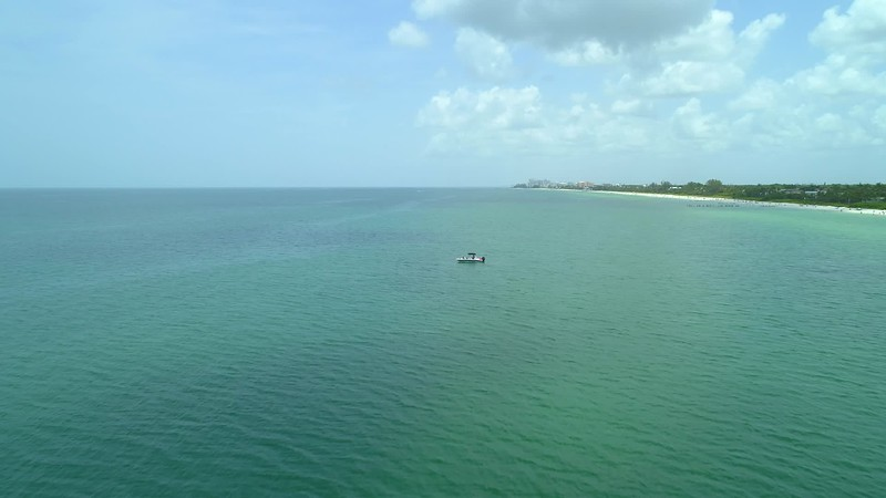 Aerial video boat in the water Gulf of Mexico Naples