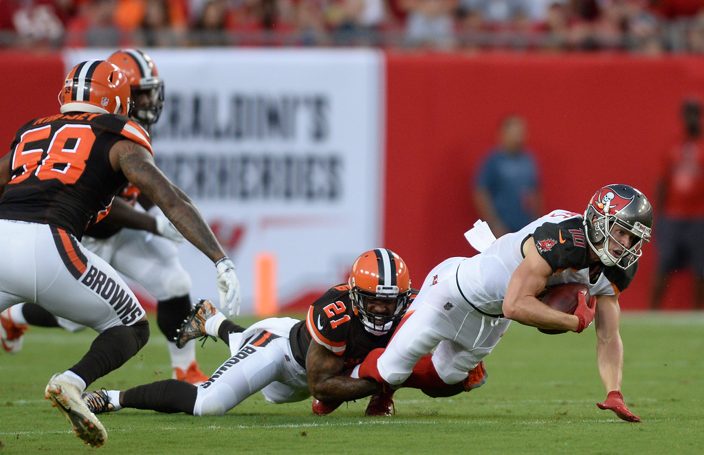 . Cleveland Browns cornerback Jamar Taylor (21) takes down Tampa Bay Buccaneers wide receiver Adam Humphries (10) after a reception during the first quarter of an NFL preseason football game Saturday, Aug. 26, 2017, in Tampa, Fla. (AP Photo/Jason Behnken)