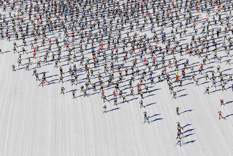 . Cross-country skiers start during the Engadin Ski Marathon on the frozen Lake Sils near the village of Maloja March 10, 2013. More than 12,000 skiers participated in the 42.2 km (26.2 miles) race between Maloja and S-chanf near the Swiss mountain resort of St. Moritz. REUTERS/Michael Buholzer
