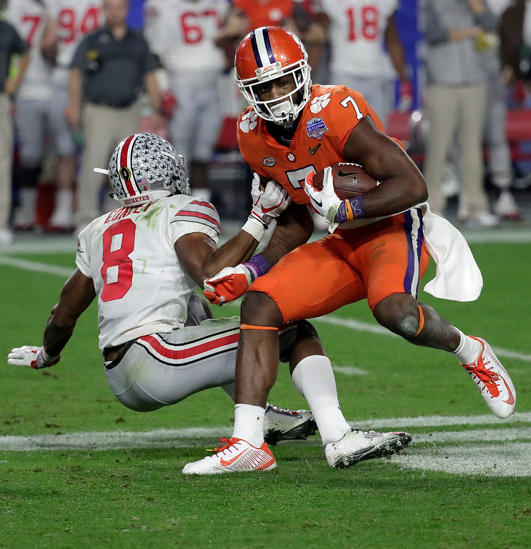 . Clemson wide receiver Mike Williams (7) is tackled by Ohio State cornerback Gareon Conley (8) during the second half of the Fiesta Bowl NCAA college football game, Saturday, Dec. 31, 2016, in Glendale, Ariz. (AP Photo/Rick Scuteri)