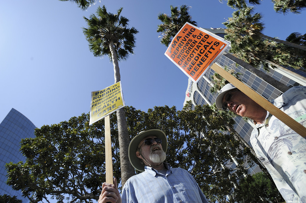 . LONG BEACH, CALIF. USA -- Retired longshoremen Dag Kolderup, left, and Dale McConnachie join other dock workers as they protest the Pacific Maritime Association (PMA) handling of their health care benefits on Monday, July 8, 2013, in Long Beach, Calif.  Photo by Jeff Gritchen / Los Angeles Newspaper Group