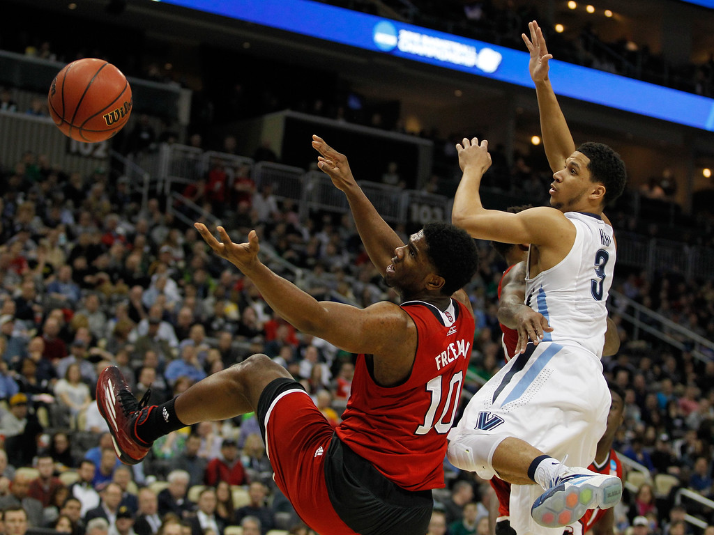 . Lennard Freeman #10 of the North Carolina State Wolfpack and Josh Hart #3 of the Villanova Wildcats go after the ball in the second half during the third round of the 2015 NCAA Men\'s Basketball Tournament at Consol Energy Center on March 21, 2015 in Pittsburgh, Pennsylvania.  (Photo by Justin K. Aller/Getty Images)