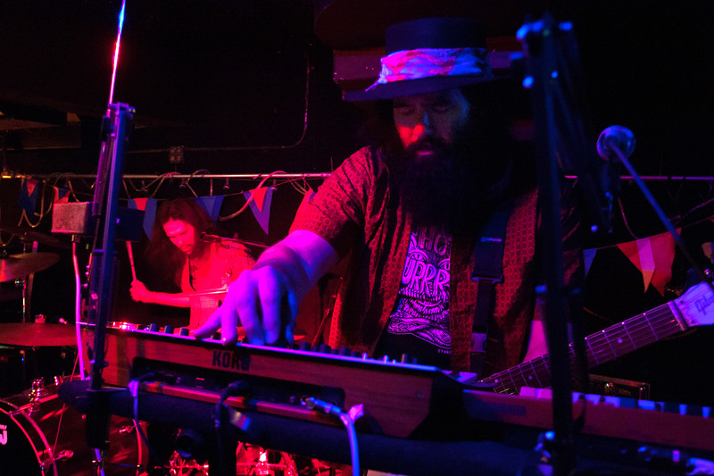 Mark Charles, with Snoozy Moon, playing keyboard during music set at Grainey's Basement for Treefort Music Fest, Boise, Idaho.