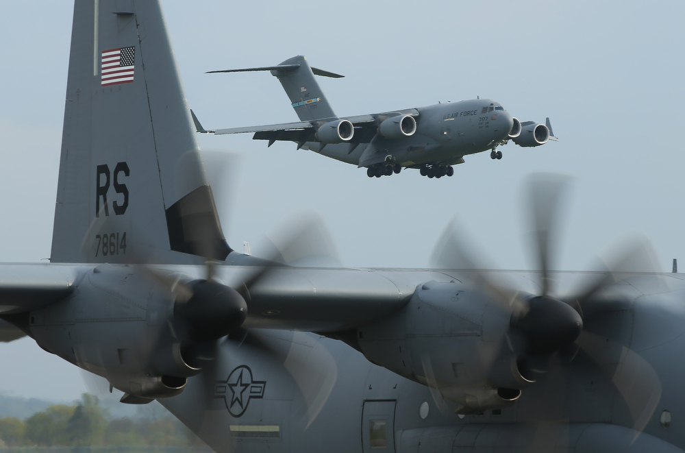 . U.S. Air Force planes ferrying men and equipment of the U.S. Army 173rd Airborne Brigade arrive at a Polish air force base on April 23, 2014 in Swidwin, Poland. Approximately 150 U.S. troops, as well as another 450 destined for the three Baltic states in coming days, will participate in bilateral military exercises over the coming weeks in a sign of commitment among NATO members. Tensions are rising in eastern Ukraine between Russian separatists and Ukrainian authorities and NATO is seeking to reassure its own members located close to Russia.  (Photo by Sean Gallup/Getty Images)