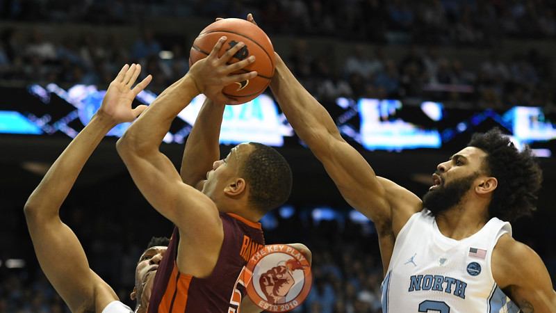 Virginia Tech Hokies guard Justin Robinson (5) has his shot blocked from behind by North Carolina Tar Heels guard Joel Berry II (2). (Michael Shroyer/ TheKeyPlay.com)