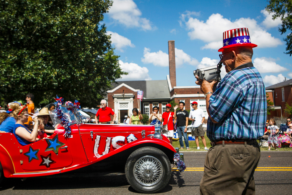 Description of . Coy Haraway, 81, of Cordova, films the Cordova Community Center's Independence Day Celebration and Parade in Cordova, Tenn. Friday, July 4, 2014. (AP Photo/The Commercial Appeal, William DeShazer)