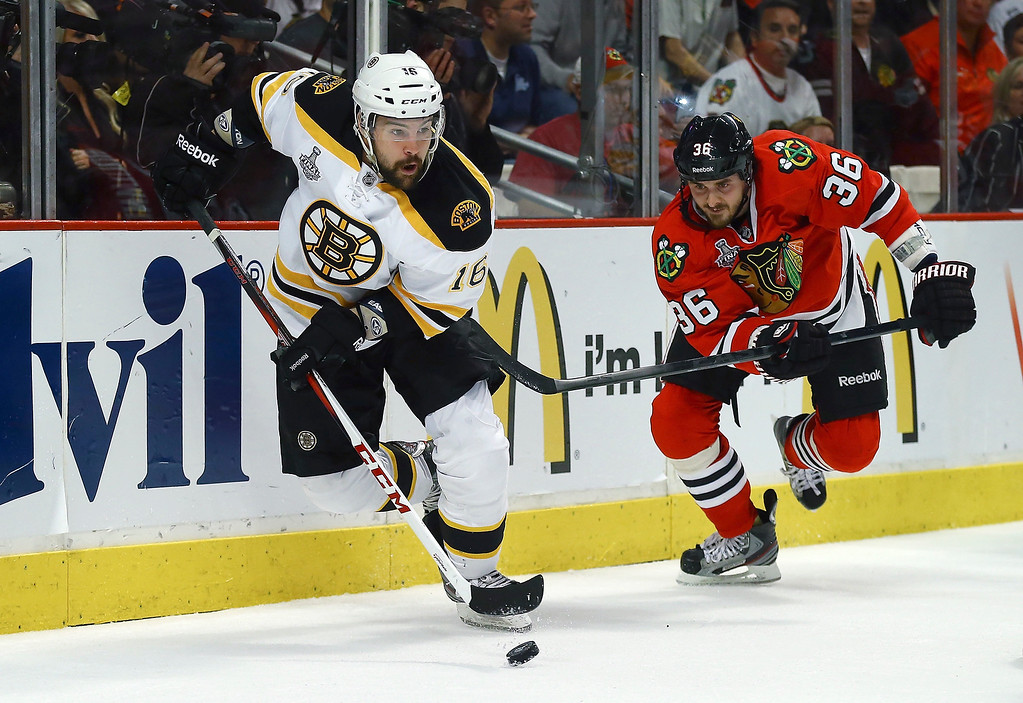 . Kaspars Daugavins #16 of the Boston Bruins skates with the puck against Dave Bolland #36 of the Chicago Blackhawks in Game One of the NHL 2013 Stanley Cup Final at United Center on June 12, 2013 in Chicago, Illinois.  (Photo by Bruce Bennett/Getty Images)