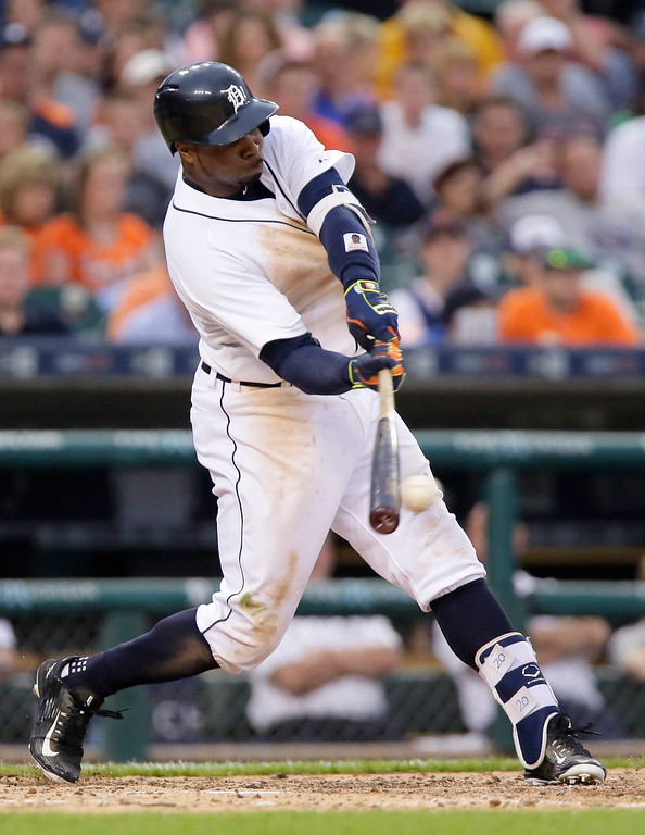 . Detroit Tigers\' Rajai Davis singles against the Cleveland Indians during the sixth inning of a baseball game Friday, June 12, 2015, in Detroit. Davis scored in the inning on a home run by Miguel Cabrera. (AP Photo/Duane Burleson)