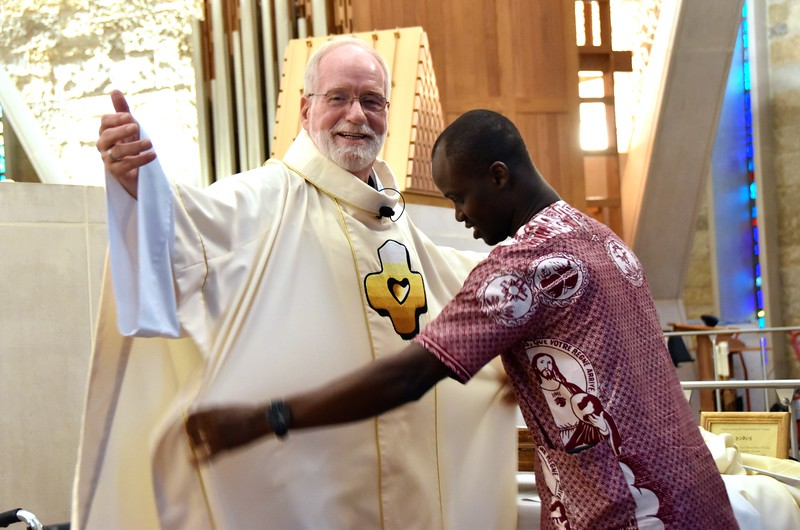 Fr. Ed is assisted by Hubert, one of our novices