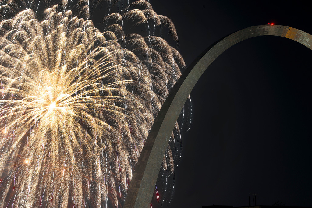 . Fireworks illuminate the night sky near the Gateway Arch on Wednesday, July 4, 2018, in St. Louis. The fireworks are part of Fair Saint Louis, the annual Independence Day celebration in the city. (AP Photo/Jeff Roberson)