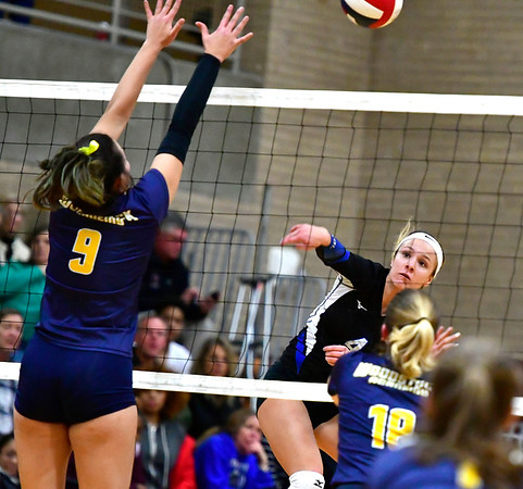 11/14/2018 Mike Orazzi | Staff Woodstock Academy's Paula Hernandez Aulet (9) and Bristol Eastern's Olivia Beaudoin (4) during the Class L Semifinal State Girls Volleyball Tournament held at Windsor High School Wednesday night.