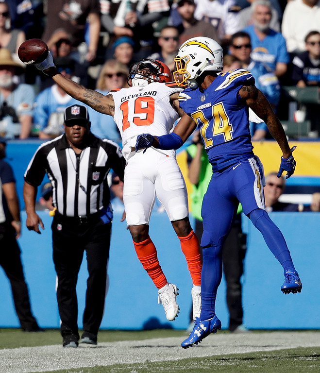 . Los Angeles Chargers cornerback Trevor Williams, right, breaks up a pass intended for Cleveland Browns wide receiver Corey Coleman during the first half of an NFL football game Sunday, Dec. 3, 2017, in Carson, Calif. (AP Photo/Jae C. Hong)