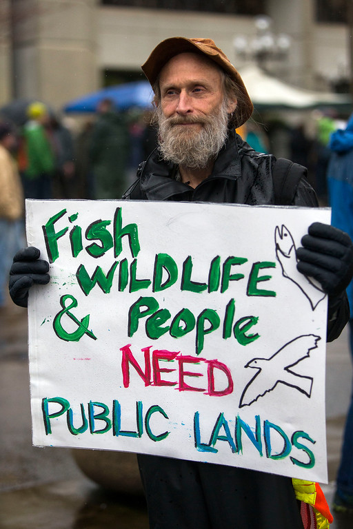 . John Perry holds a poster during a rally against the occupation of the Malheur National Wildlife Refuge by Ammon Bundy and his armed followers, while joining the rally at the Federal Building in Eugene, Ore., Tuesday, Jan. 19, 2016. With the armed takeover of the national wildlife refuge in southeastern Oregon in its third week, Bundy and his armed group are still trying to muster up broad community support, so far without much luck. (Andy Nelson/The Register-Guard via AP) MANDATORY CREDIT