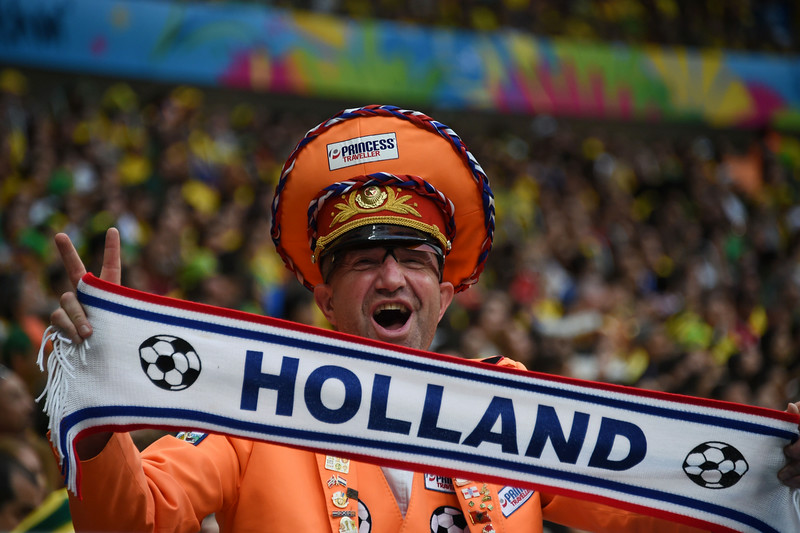 . A Netherlands fan cheers for his team during the third place play-off football match between Brazil and Netherlands during the 2014 FIFA World Cup at the National Stadium in Brasilia on July 12, 2014. (VANDERLEI ALMEIDA/AFP/Getty Images)