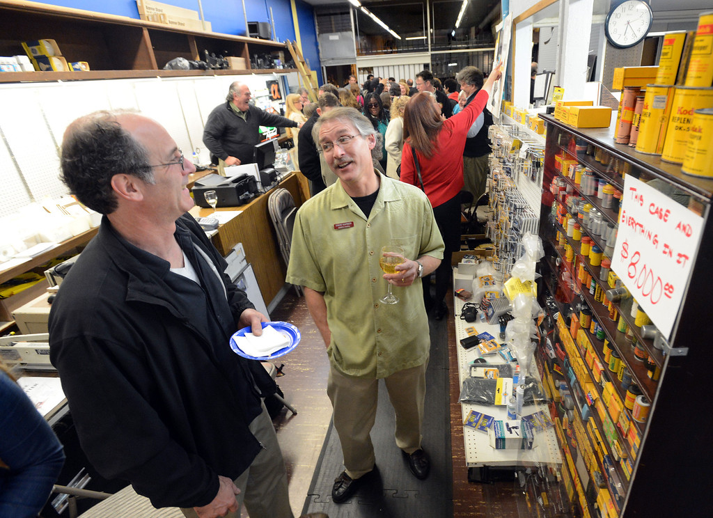 . Mark Spandorf, of Oakland, left, talks to David Sarber, owner of Sarber\'s Cameras during a farewell event for Sarber\'s Cameras in Oakland, Calif., on Friday, Feb. 1, 2013. The store was bought in 1961 by Peter and Nancy Sarber and moved to Montclair in 1964. After more than a half-century in business, Sarber\'s Cameras is closing. The Sarber family held the farewell event for longtime customers, friends and family in Montclair Village. (Doug Duran/Staff)