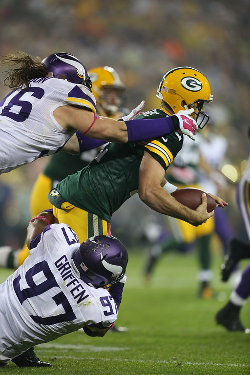 . GREEN BAY, WI - OCTOBER 2: Quarterback Aaron Rodgers #12 of the Green Bay Packers is sacked by Brian Robison #96 and Everson Griffen #97 of the Minnesota Vikingson October 02, 2014 at Lambeau Field in Green Bay, Wisconsin. (Photo by John Konstantaras/Getty Images)
