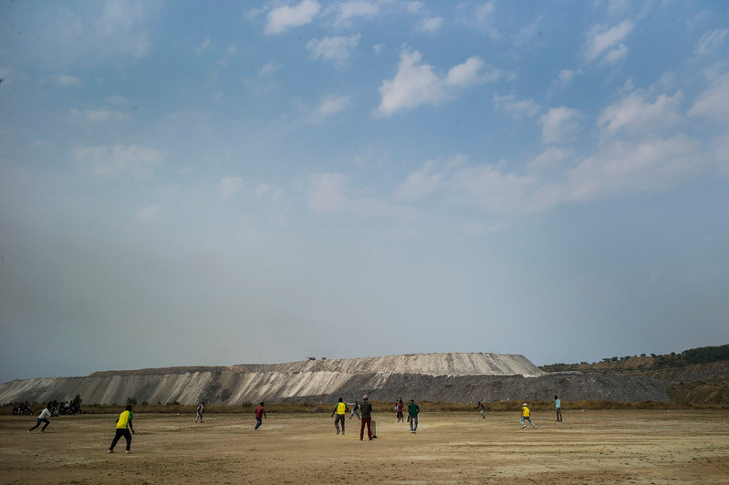 Chattisgarh, India, February 2015:   Local youth play cricket near the Kusumunda open cast coal field.   Photographs for a story on land allocation for coal mines in Chattisgarh.  Modi's new government in the centre has relaxed the environmental regulations so the land can be allocated to both public and private sector companies easily.   Photo by Sami Siva for Al Jazeera America.