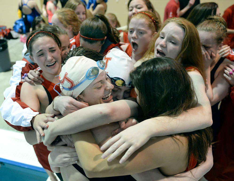 . THORNTON, CO. - FEBRUARY 15, 2014: Members of the Regis 400-yard Freestyle Relay team were surrounded by teammates following their win Saturday. Regis also took the team title. The CHSAA 5A Girl\'s State Swimming Championships wrapped up Saturday night February 14, 2104.  Photo By Karl Gehring/The Denver Post