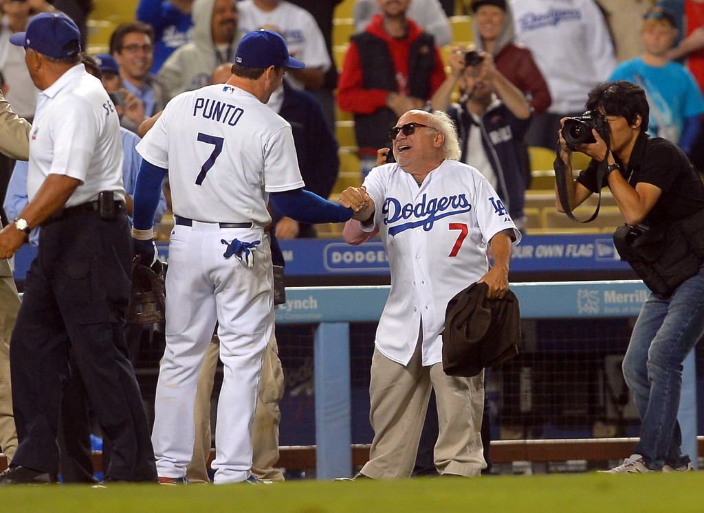 . Danny DeVito congratulates Nick Punto following the Dodgers 4-2 victory over the Mets August 12, 2013.  The Dodgers are hosting the Mets for a three game series.(Andy Holzman/Los Angeles Daily News)