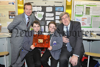 PRESS RELEASE IMAGE  10/1/14: Local young scientists showcase their talents in Dublin  Education Minister, John O'Dowd, pictured with (left) Cormac Hardy and Eoin McGivern from St Louis Grammar, Kilkeel and Peter Morris, BT Ireland as he viewed the BT Young Scientist and Technology Exhibition 2014 in Dublin.  The Minister today toured the event, held at the RDS, and met with pupils to view displays of their work. Across the 16 local schools represented, a total of 28 individual projects have made it to the finals. Picture: Michael Cooper
