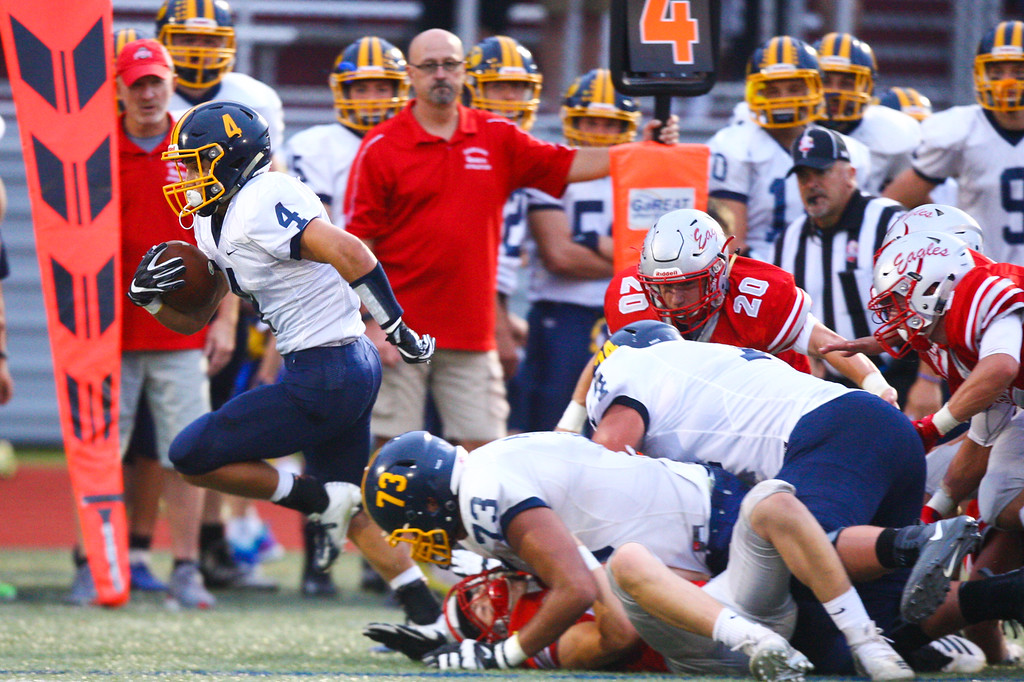 . David Turben - The News-Herald Kirtland\'s Joey Torok (4) breaks free around the end scoring on a long TD run on a short fourth down play.
