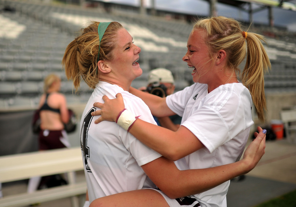 . COMMERCE CITY, CO. - MAY 22 : Hannah Gerdin (14), left, and Lauren Case (18) of Cheyenne Mountain High School celebrate winning of 4A girl\'s soccer championship game against Broomfield High School at Dick\'s Sporting Goods Park. Commerce City, Colorado. May 22, 2013. Cheyenne Mountain High School won 2-0. (Photo By Hyoung Chang/The Denver Post)