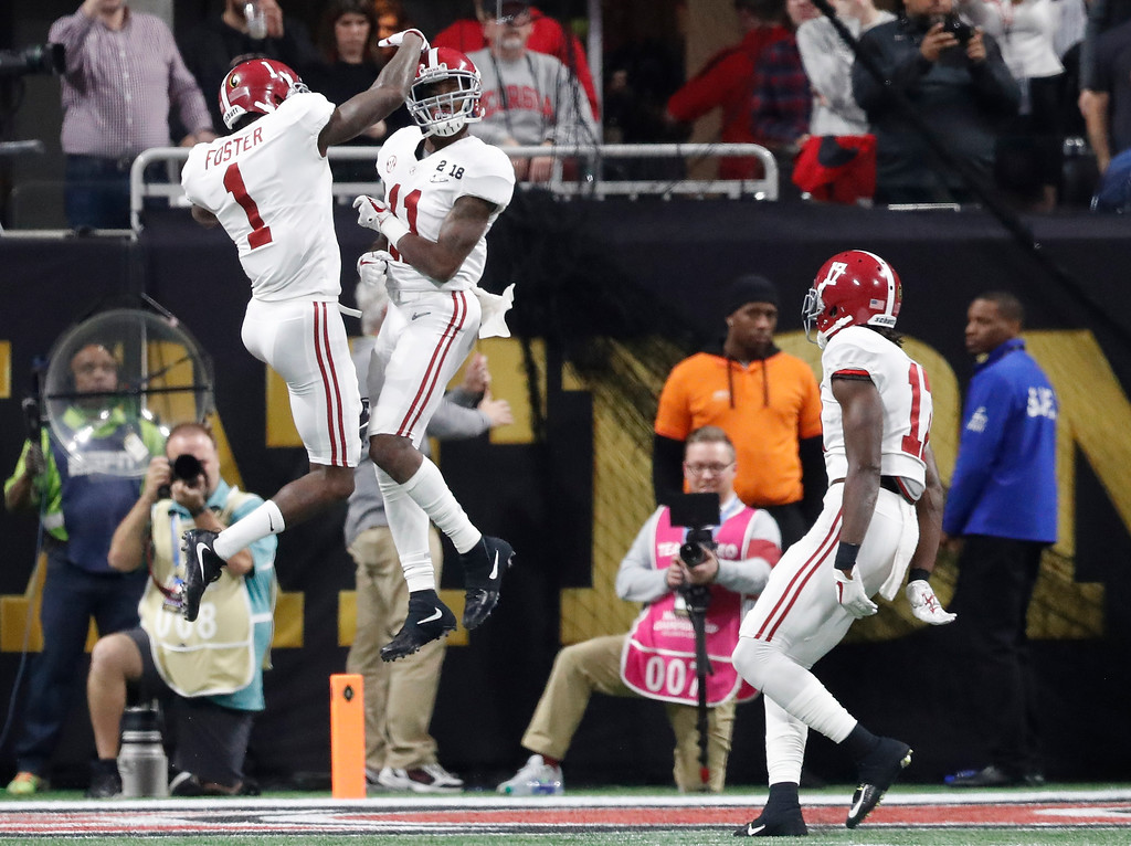 . Alabama\'s Henry Ruggs III is congratulated by Robert Foster (1) after a touchdown catch during the second half of the NCAA college football playoff championship game against Georgia Monday, Jan. 8, 2018, in Atlanta. (AP Photo/David Goldman)