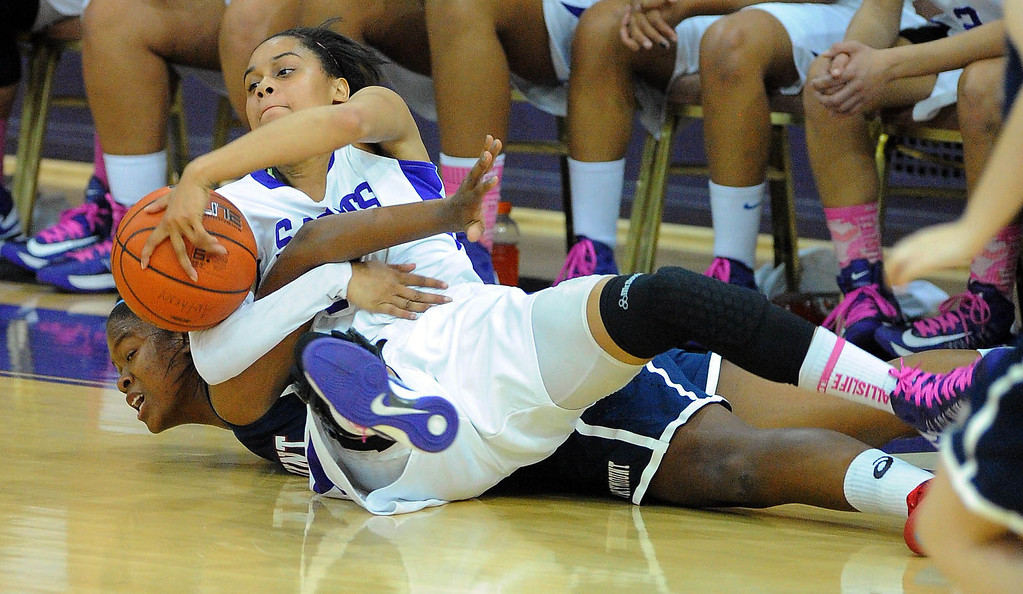 . LONG BEACH - 02/14/13 - (Photo: Scott Varley, Los Angeles Newspaper Group)  CIF-SS Div 4AA girls basketball playoff between Marymount Sailors and host St. Anthony Lady Saints. Saint Anthony\'s Jordan Jackson gets tangled with Chyanne Perkins as they go after a loose ball.