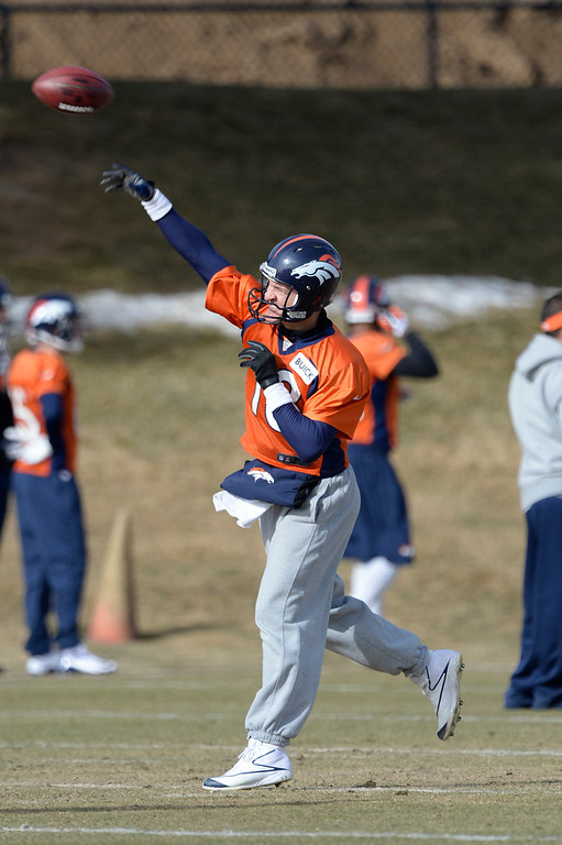 . Denver Broncos quarterback Peyton Manning (18) throws a pass during practice January 16, 2014 at Dove Valley. The Denver Broncos are preparing for their AFC Championship game against the New England Patriots at Sports Authority Field.  (Photo by John Leyba/The Denver Post)