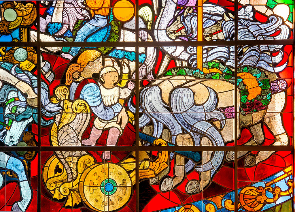 """. PIH Health has purchased the former Montebello, Calif. Home Savings and Loan to use as an urgent care facility.  Two historic items, a stained glass window, �The Carousel�, pictured, designed by Susan Hertel and fabricated by John Wallis and Associates on the south fa�ade, and a mosaic mural, \""""A Day in the Country\"""", designed by Millard Sheets and executed by Nancy Colbath on the building�s north fa�ade will be preserved by PIH at the Beverly Boulevard location Jan. 21, 2014. (Staff photo by Leo Jarzomb/Whittier Daily News)"""