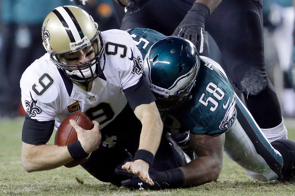 . Philadelphia Eagles\' Trent Cole (58) tackles New Orleans Saints\' Drew Brees (9) during the first half of an NFL wild-card playoff football game, Saturday, Jan. 4, 2014, in Philadelphia. (AP Photo/Matt Rourke)