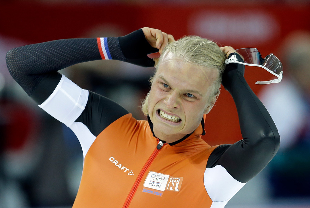 . Silver medalist Koen Verweij of the Netherlands grabs his hair when the race was declared a tie with gold medalist Poland\'s Zbigniew Brodka  in the men\'s 1,500-meter speedskating race at the Adler Arena Skating Center during the 2014 Winter Olympics in Sochi, Russia, Saturday, Feb. 15, 2014. Verweij later was later declared silver, losing by three thousandth of a second. (AP Photo/Patrick Semansky)