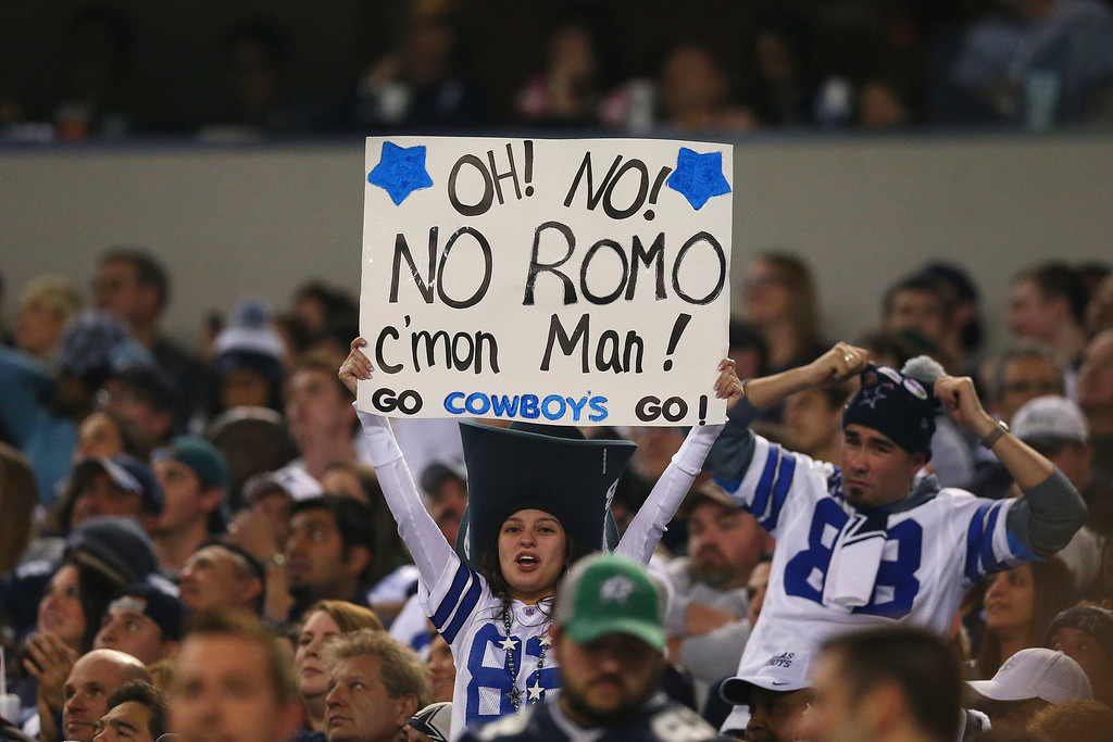 . A Dallas Cowboys fan holds up a sign during their game against the Philadelphia Eagles at Cowboys Stadium on December 29, 2013 in Arlington, Texas.  (Photo by Ronald Martinez/Getty Images)