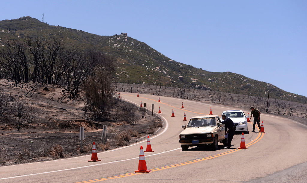 . CHP and Sheriff personnel stop drivers along Highway 243 near Poppet Flats Road in the mountains south of Banning August 10, 2013.   GABRIEL LUIS ACOSTA/STAFF PHOTOTGRAPHER.