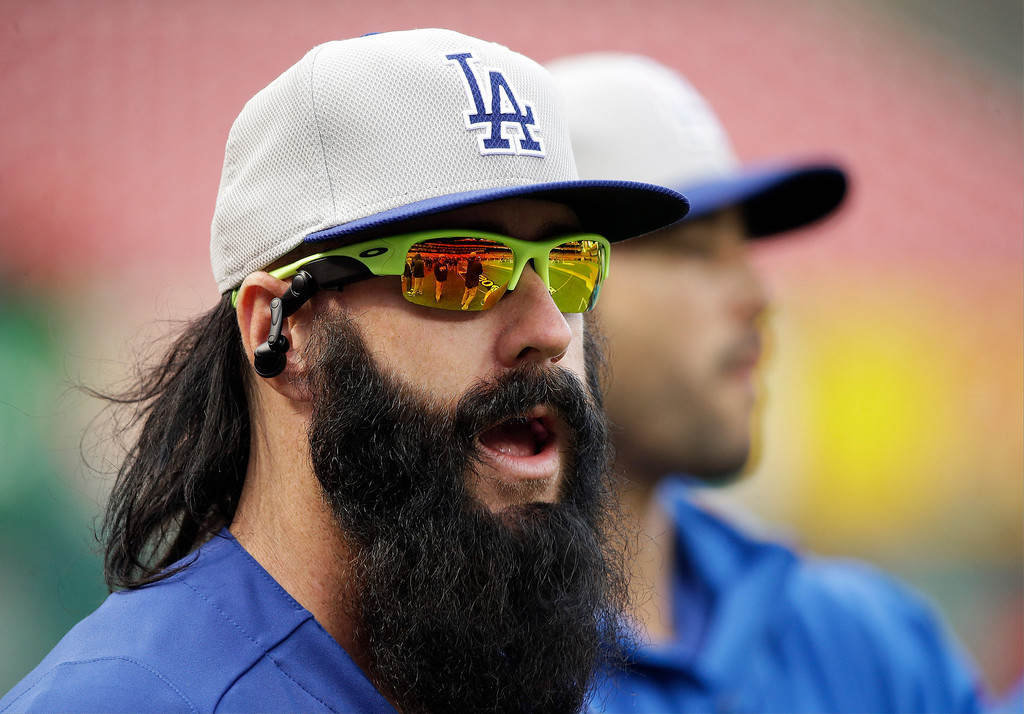 . Los Angeles Dodgers relief pitcher Brian Wilson warms up before Game 6 of the National League baseball championship series against the St. Louis Cardinals, Friday, Oct. 18, 2013, in St. Louis. (AP Photo/Charlie Neibergall)