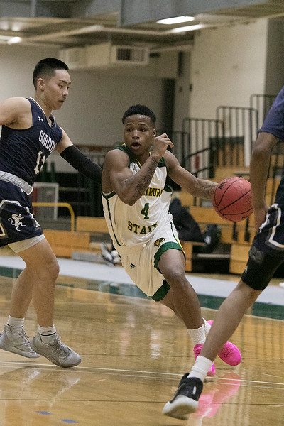 Fitchburg State University mens basketball played Gordon College on thursday night at FSU's Recreation Center. FSU's #4 Devon Johnson tries to get around GC's #13 Justin Yu. SENTINEL & ENTERPRISE/JOHN LOVE