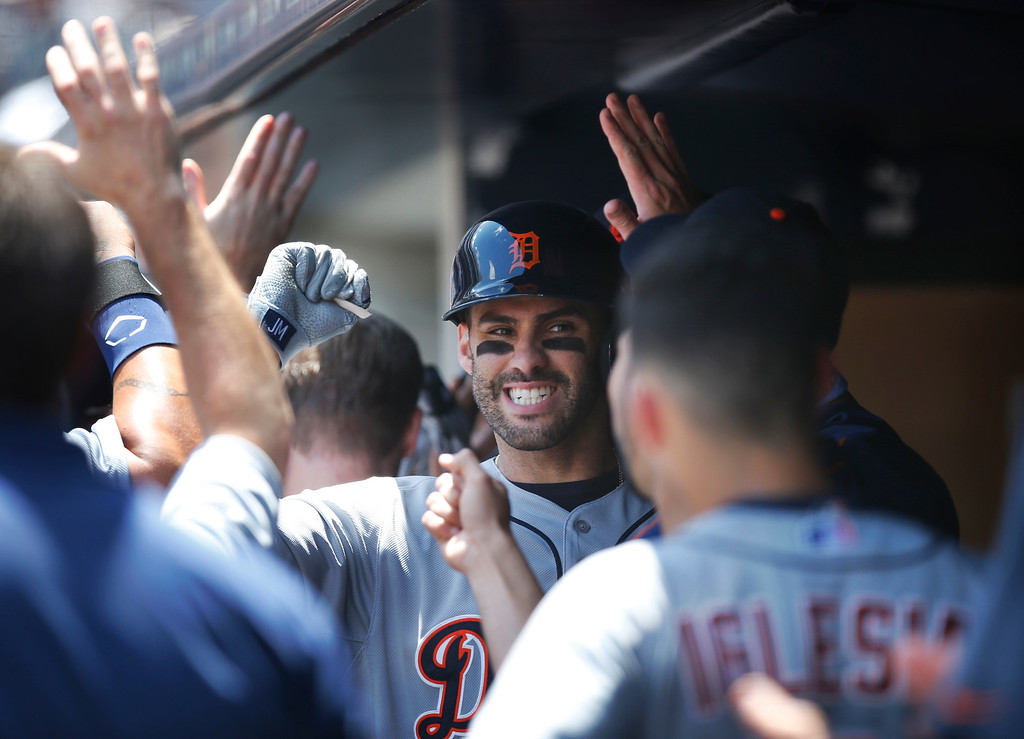 . Teammates congratulate Detroit Tigers J.D. Martinez, center, after he hit a first-inning, two-run home run off New York Yankees starting pitcher Masahiro Tanaka in a baseball game at Yankee Stadium in New York, Sunday, June 21, 2015. (AP Photo/Kathy Willens)