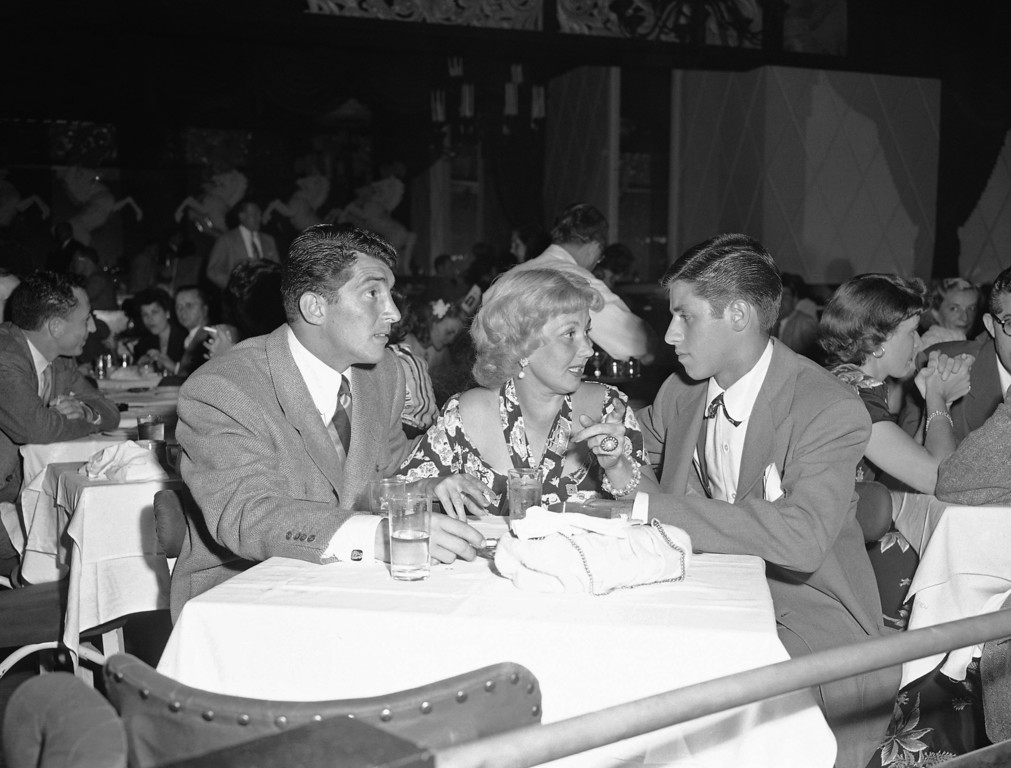 . On a visit to Slapsy Maxie\'s Hollywood night club, actress Ann Sothern chats with two of the club\'s performers, Dean Martin, left, singer and comedian, and Jerry Lewis, comedian, Aug. 14, 1948. Lewis, the comedian and director whose fundraising telethons became as famous as his hit movies, has died. Publicist Candi Cazau said Lewis passed away Sunday, Aug. 20, 2017, at age 91 in Las Vegas with his family by his side. (AP Photo/Ed Widdis)
