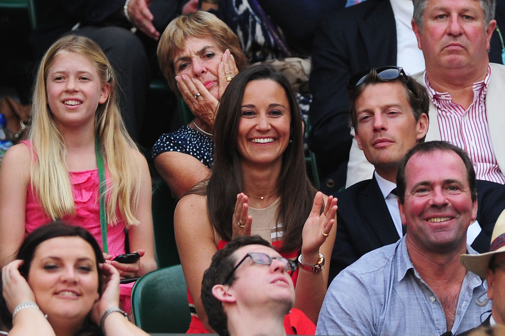 . LONDON, ENGLAND - JULY 05:  Pippa Middleton applauds as she watches the Gentlemen\'s Singles semi-final match between Andy Murray of Great Britain and Jerzy Janowicz of Poland on day eleven of the Wimbledon Lawn Tennis Championships at the All England Lawn Tennis and Croquet Club on July 5, 2013 in London, England.  (Photo by Mike Hewitt/Getty Images)