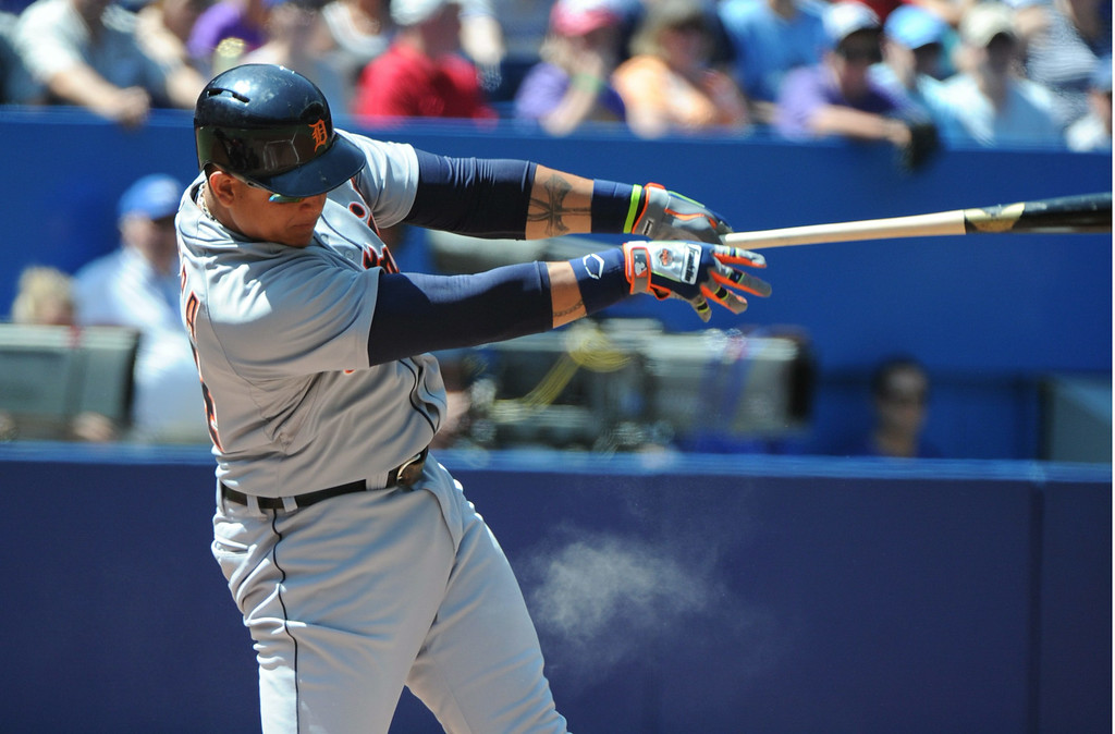 . Detroit Tigers\' Miguel Cabrera hits a single against the Toronto Blue Jays during the first inning of a baseball game on Sunday, Aug. 10, 2014, in Toronto.  (AP Photo/The Canadian Press, Jon Blacker)