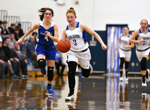 2/13/2020 Mike Orazzi | StaffrLewis Mills' Lauren Alvarez (4) and Bristol Eastern's Jessica Levesque (3) during Thursday night's girls basketball game in Bristol.