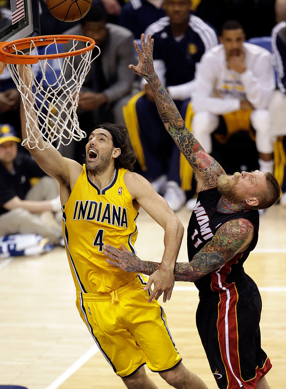 . Indiana Pacers forward Luis Scola (4) shots in front of Miami Heat forward Chris Andersen (11) during the first half of Game 2 of the NBA basketball Eastern Conference finals in Indianapolis, Tuesday, May 20, 2014. (AP Photo/AJ Mast)
