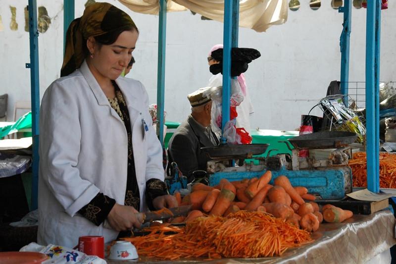 Tajik Woman Chopping Carrots - Dushanbe, Tajikistan