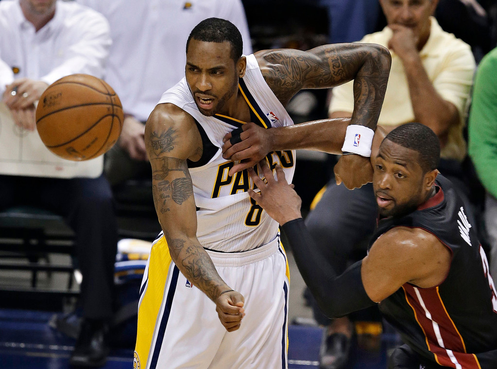 . Indiana Pacers\' Rasual Butler, left, and Miami Heat\'s Dwyane Wade watch a loose ball during the first half of Game 5 of the Eastern Conference finals NBA basketball playoff series Wednesday, May 28, 2014, in Indianapolis. (AP Photo/Darron Cummings)