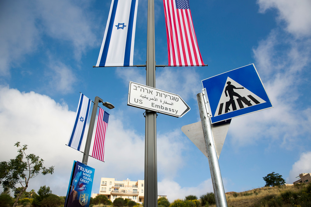 . A road sign leading to the U.S. Embassy is seen ahead the official opening in Jerusalem, Sunday, May 13, 2018. Monday\'s opening of the U.S. Embassy in contested Jerusalem, cheered by Israelis as a historic validation, is seen by Palestinians as an in-your-face affirmation of pro-Israel bias by President Donald Trump and a new blow to frail statehood dreams. (AP Photo/Ariel Schalit)