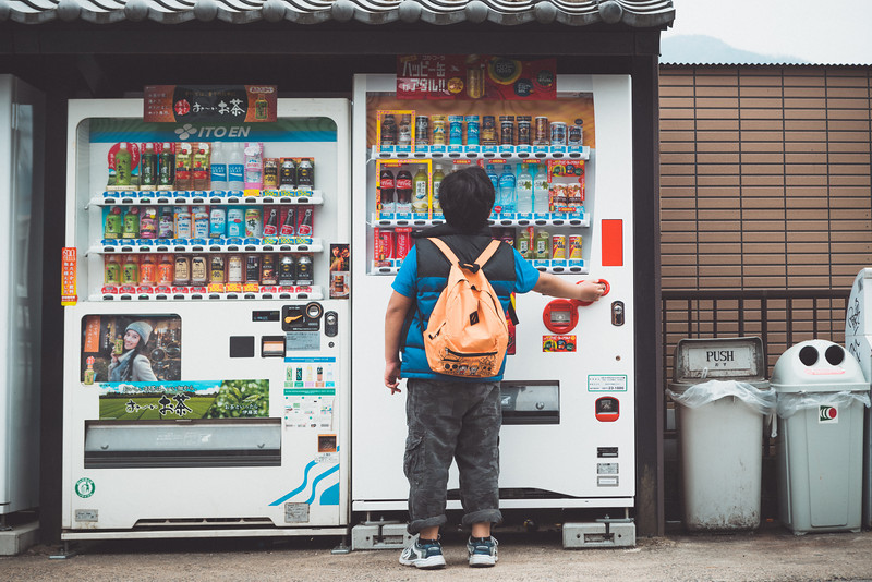 Street Photography of boy getting soda shot with the Sony A7r