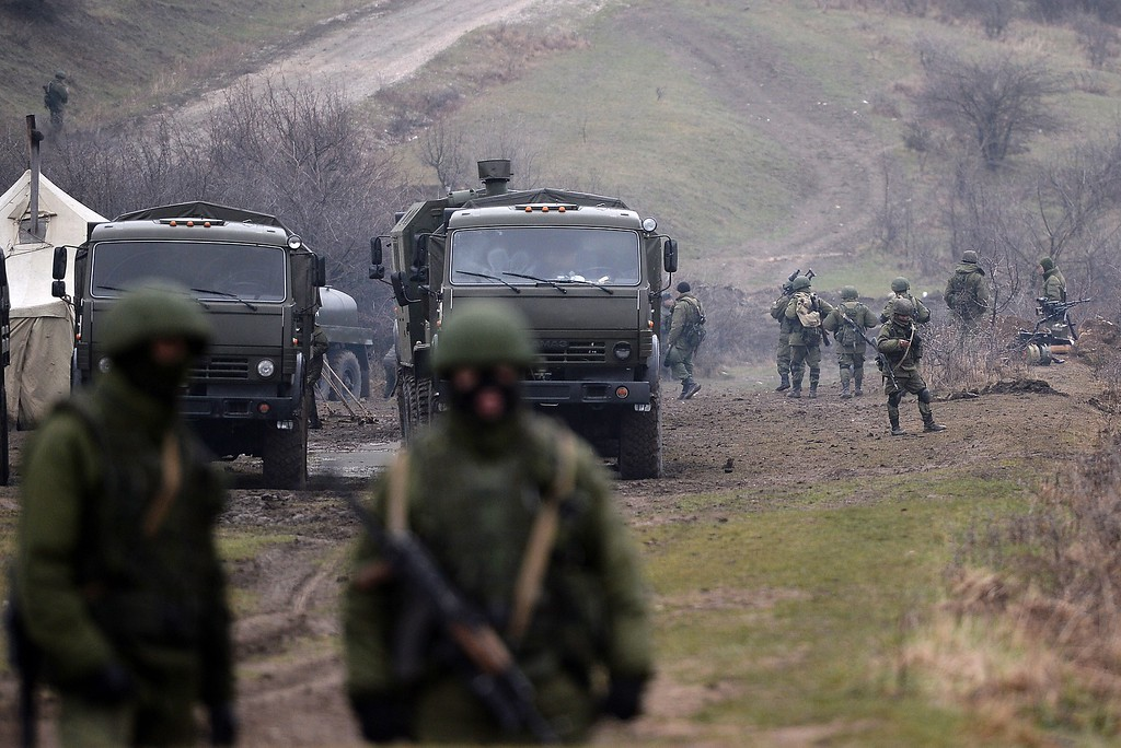". Russian soldiers patrol the area surrounding the Ukrainian military unit in Perevalnoye, outside Simferopol, on March 20, 2014. Kiev will never recognize Russia\'s annexation of Crimea and will fight for the ""liberation\"" of the strategic Black Sea peninsula, Ukraine\'s parliament said in a resolution adopted on March 20. AFP PHOTO/ Filippo  MONTEFORTE/AFP/Getty Images"