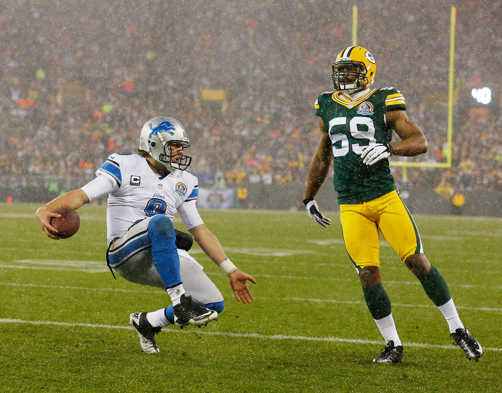 . Detroit Lions\' Matthew Stafford reacts after running for a touchdown against Green Bay Packers\' Brad Jones (59) during the first half of an NFL football game Sunday, Dec. 9, 2012, in Green Bay, Wis. (AP Photo/Jeffrey Phelps)